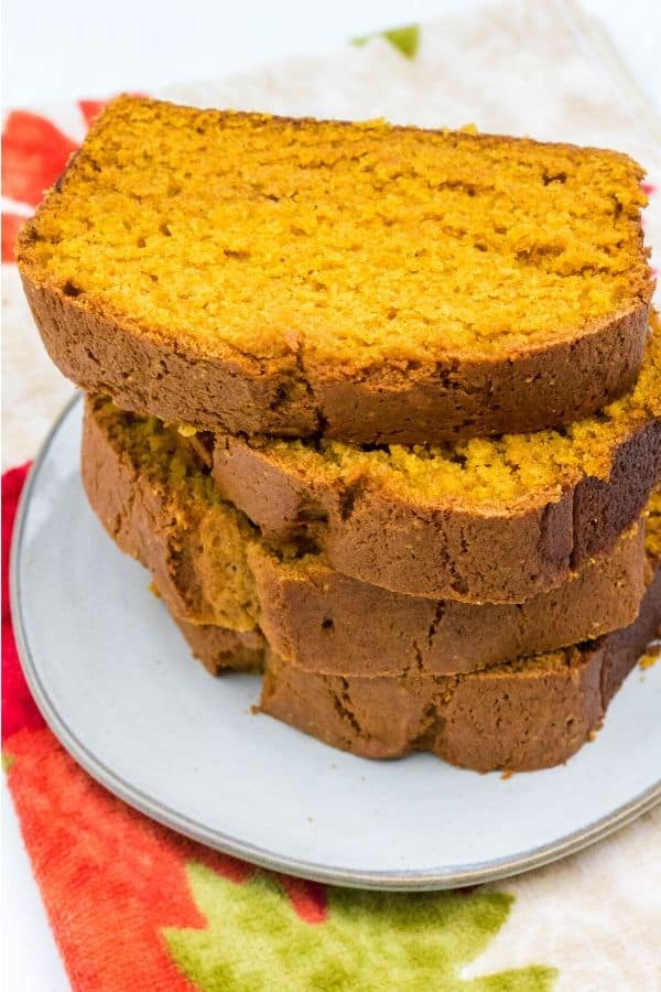 stack of four slices of pumpkin bread