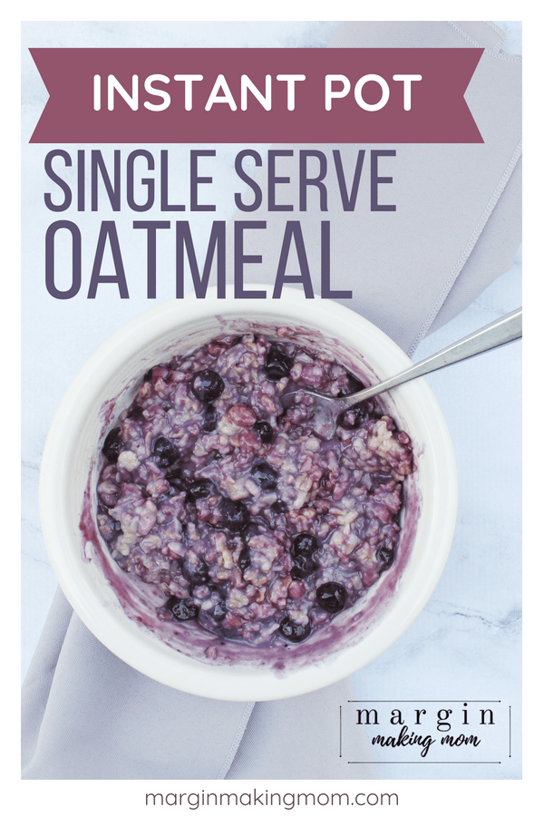 white bowl filled with instant pot oatmeal with blueberries mixed in