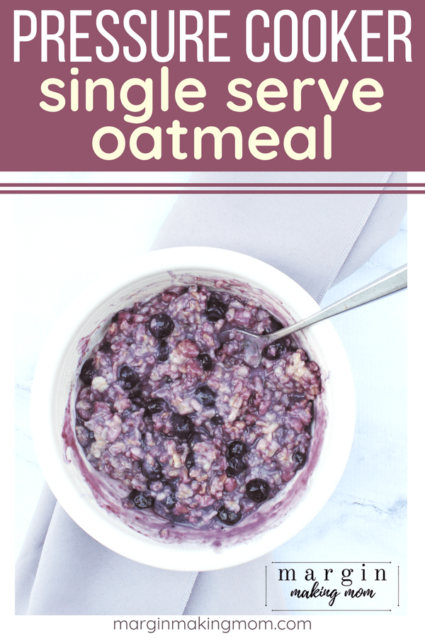 White bowl full of Instant Pot oatmeal with blueberries mixed in