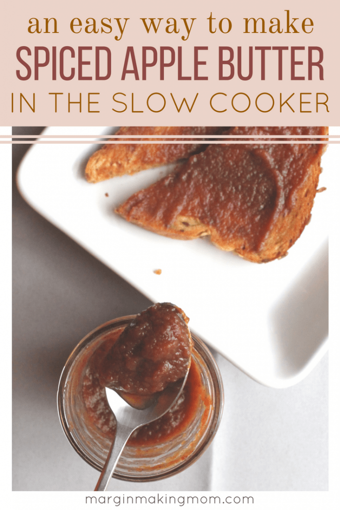 This slow cooker apple butter is the perfect blend of fall spices and sweet apples. Making it in the slow cooker makes it so easy! It is perfect on top of toast, English muffin bread, biscuits, rolls, or scones! Slow Cooker Apple Butter | Homemade Apple Butter | Easy Apple Butter | Thanksgiving Recipes
