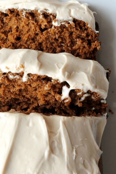 This warmly spiced gingerbread is topped with an amazing maple cream cheese frosting. It's the perfect holiday treat! Gingerbread Recipes | Maple Cream Cheese Frosting | Christmas Recipes | Holiday Recipes | Holiday Dessert Recipes | Christmas Dessert Recipes