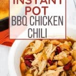 white bowl of bbq chicken chili next to a skillet of cornbread