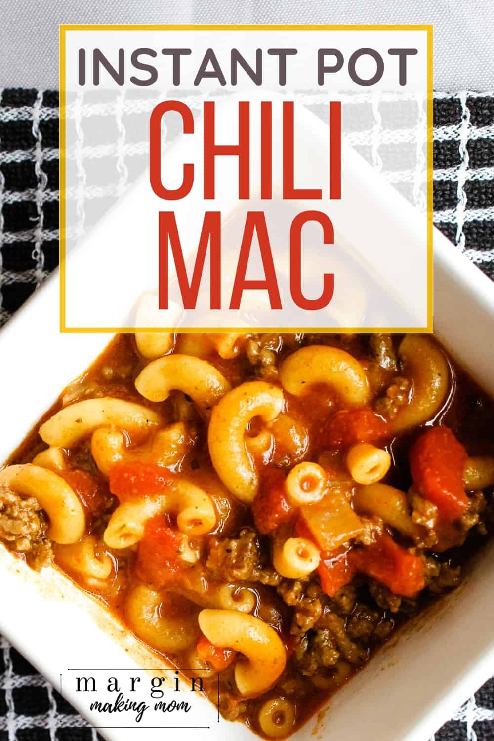Instant Pot chili mac made with beef, noodles, and tomatoes in a white bowl