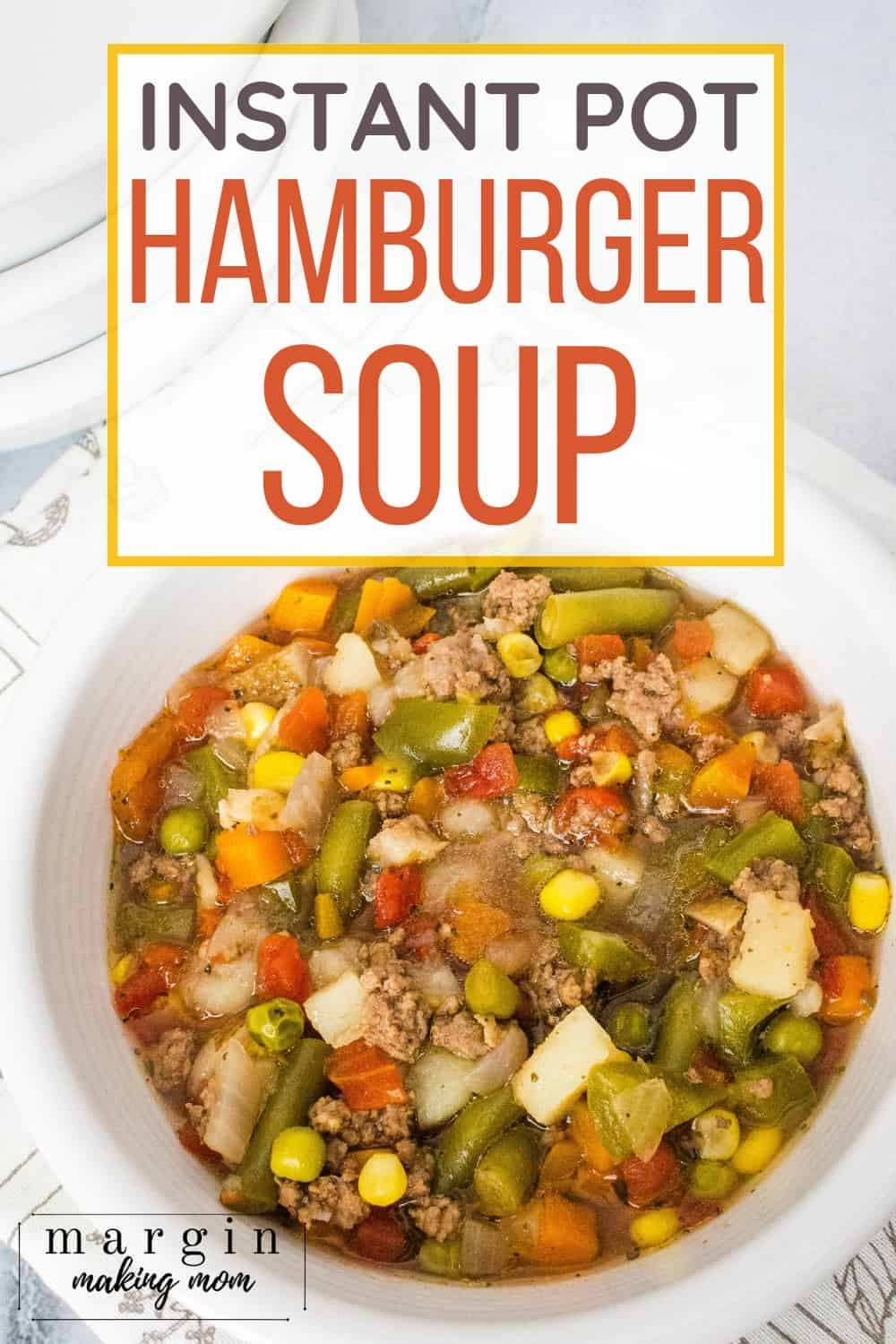 white bowl filled with hamburger soup cooked in the Instant Pot