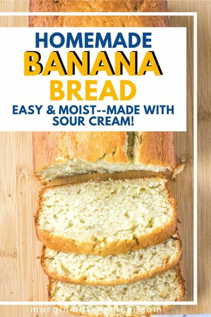 A loaf of banana bread made with sour cream, partially sliced on a cutting board