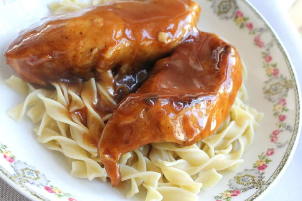 instant pot bbq ribs on a bed of egg noodles