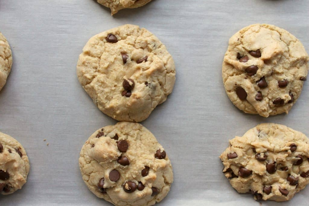 These perfectly chewy chocolate chip cookies will knock your socks off! They are delightfully soft, chock full of chips, and have a deep flavor from the brown sugar and melted butter. Click through to learn how to make them!