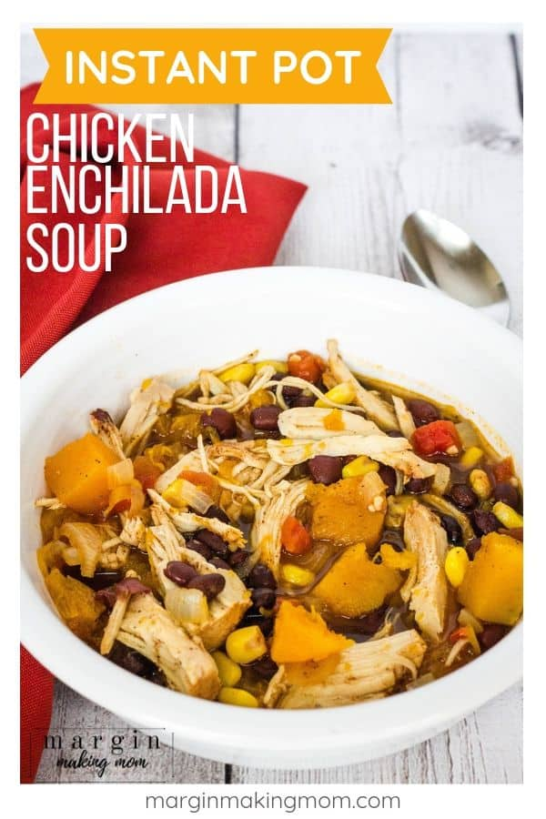 Instant Pot chicken and sweet potato enchilada soup in a white bowl