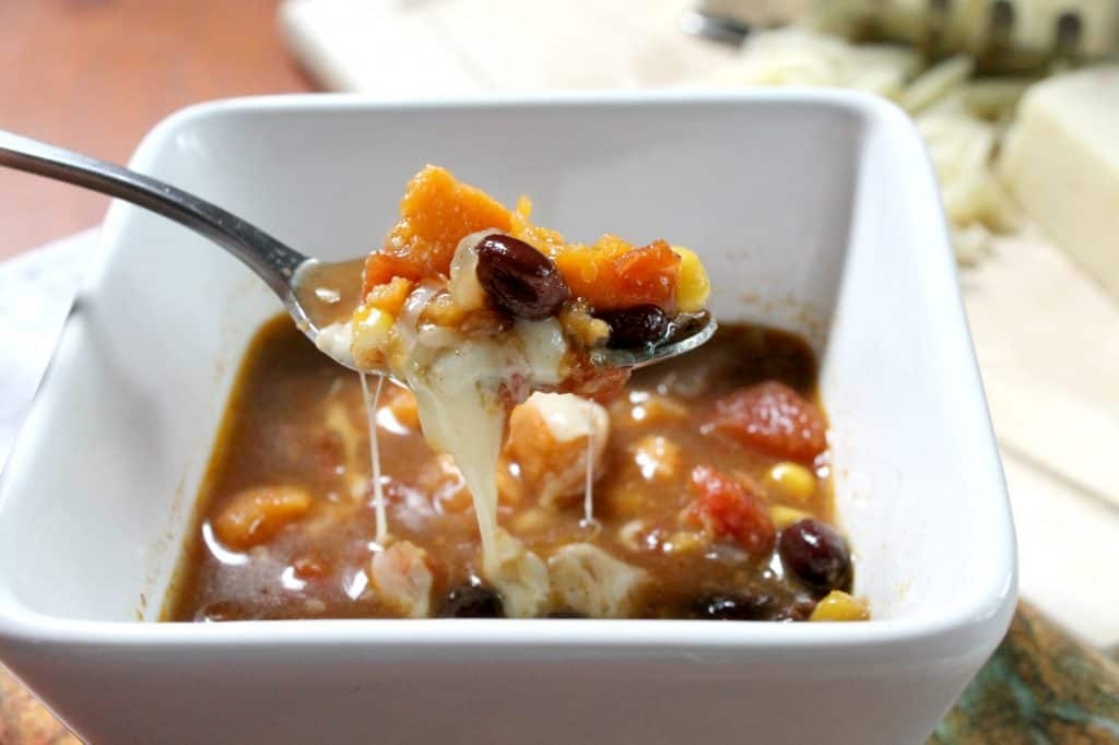 This pressure cooker sweet potato enchilada soup cooks in just minutes! It's a frugal vegetarian meal that's full of flavor, and one you're sure to love. Click through to learn how!