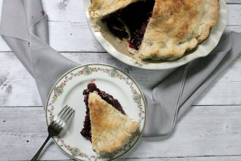 This deep dish blackberry pie is chock full of bursting berries--it's the perfect way to harness the sweetness of summer's berry bounty!