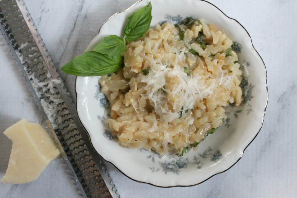 Making risotto in the Instant Pot pressure cooker saves a lot of time compared to the traditional method of preparation! It's creamy, easy, and delicious! Click through to learn how to easy it is!