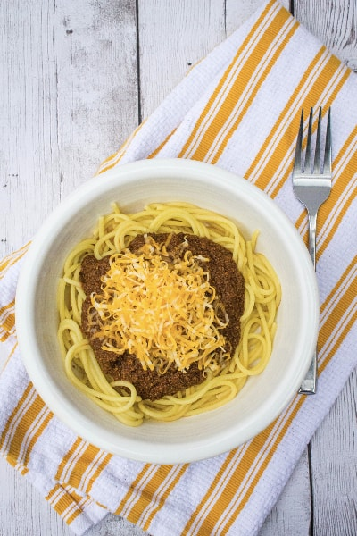white bowl filled with spaghetti and cincinnati chili made in the Instant Pot