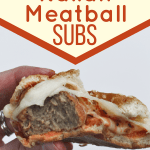 Hand holding a meatball sub