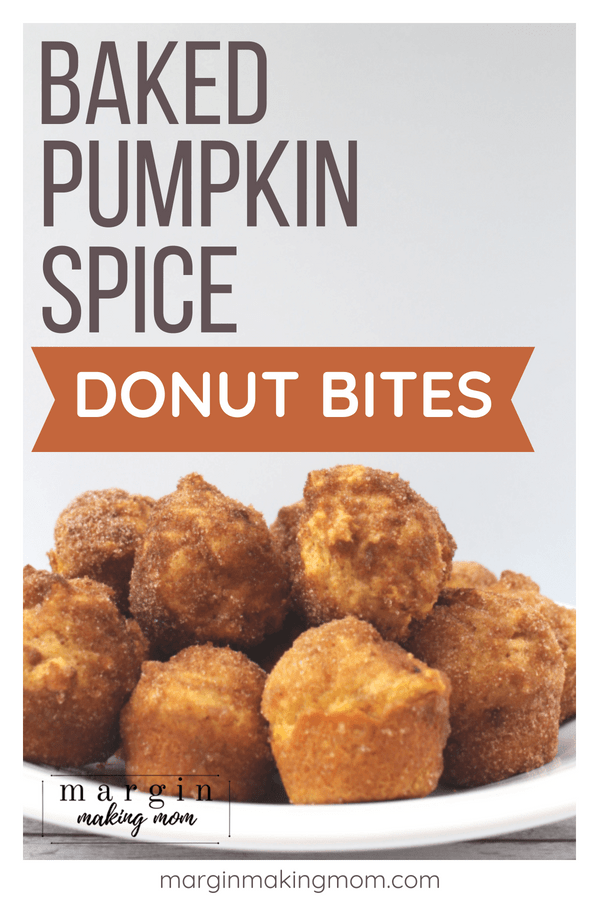 White plate piled with several pumpkin donut holes