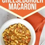 white bowl with instant pot cheeseburger macaroni on top of an orange cloth napkin