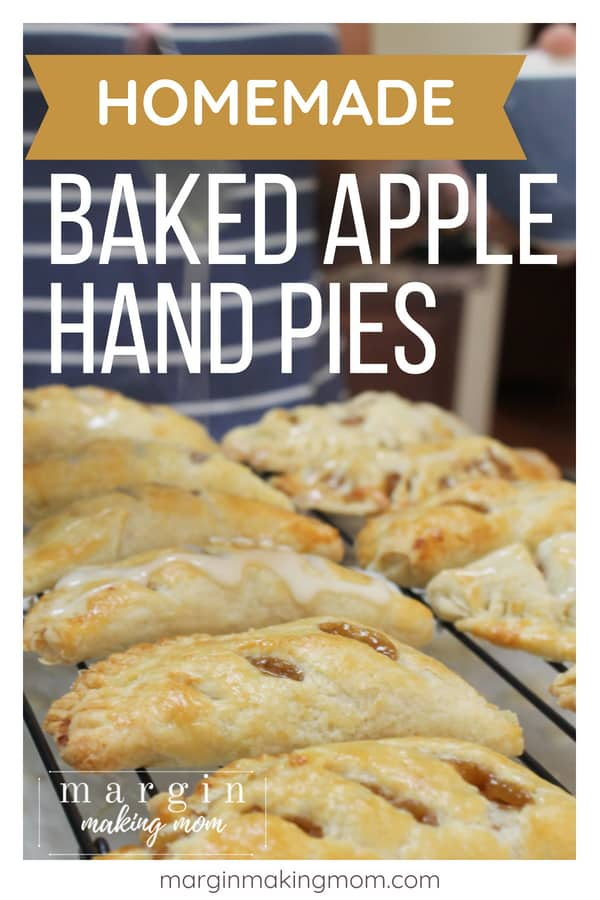 cooling rack topped with several baked apple hand pies