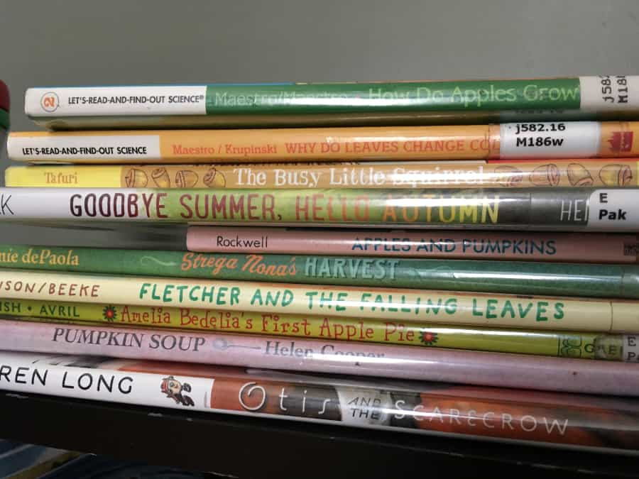 stack of kids books about fall
