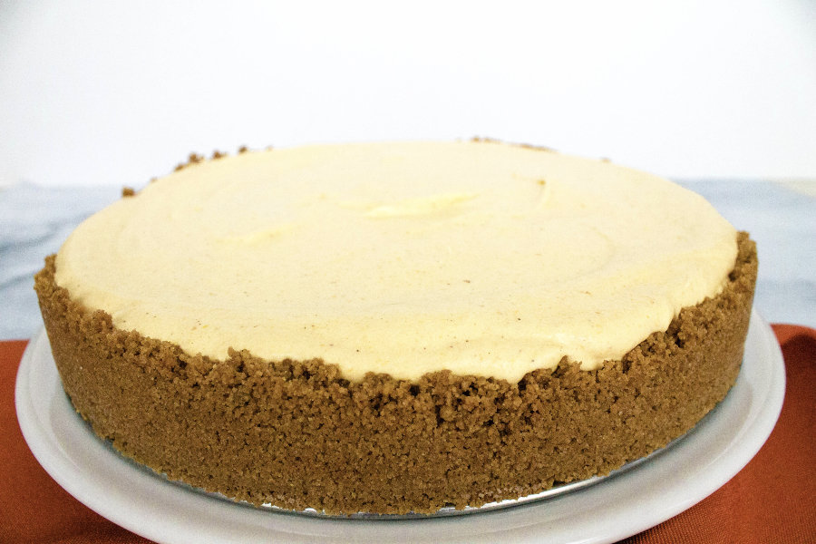 frozen pumpkin cheesecake on a white plate
