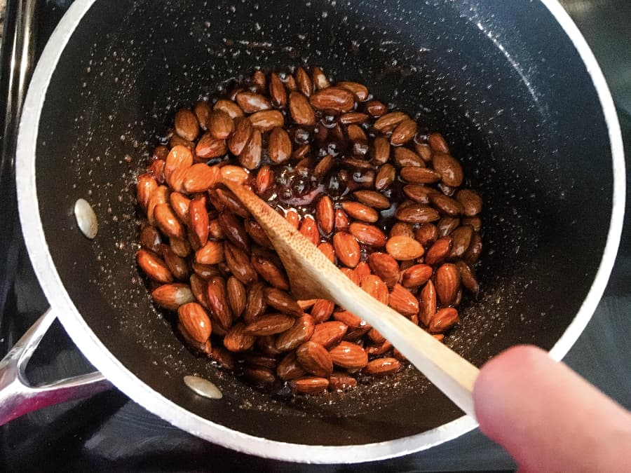 cooking candied almonds on the stove