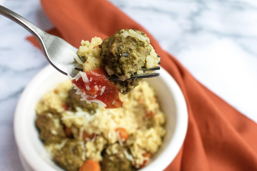 fork with a bite full of meatballs and rice made in the instant pot
