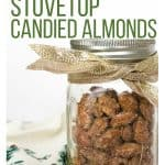 glass jar of candied almonds wrapped with a sparkly gold ribbon