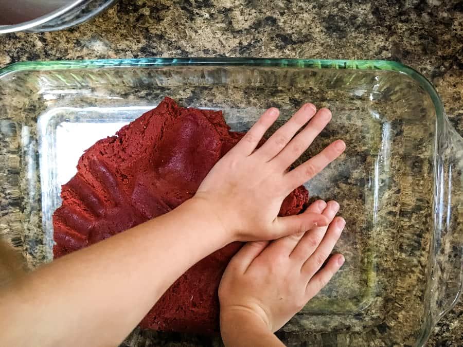 Red velvet cake mix bars being prepared