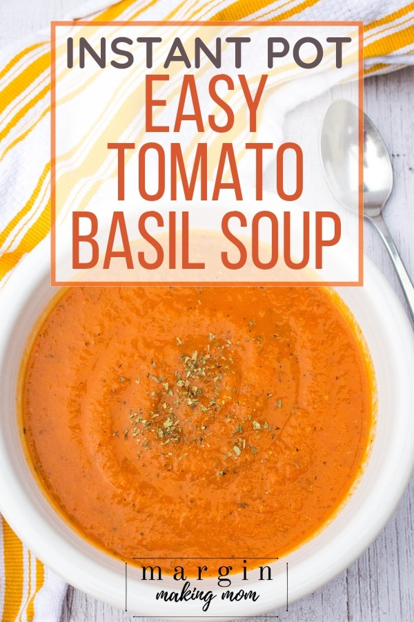 white bowl filled with tomato soup made in the Instant Pot
