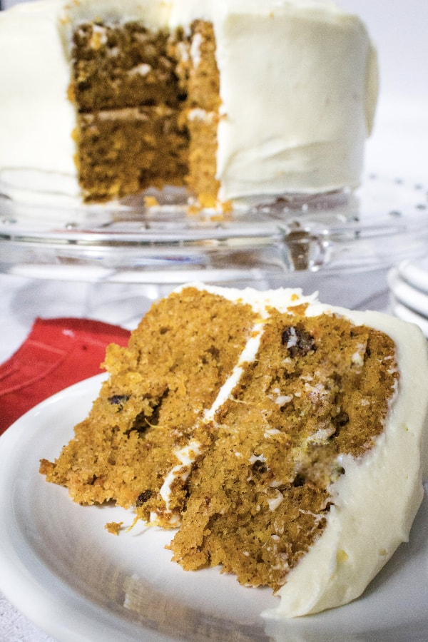 piece of canned carrot cake with cream cheese frosting on a white plate