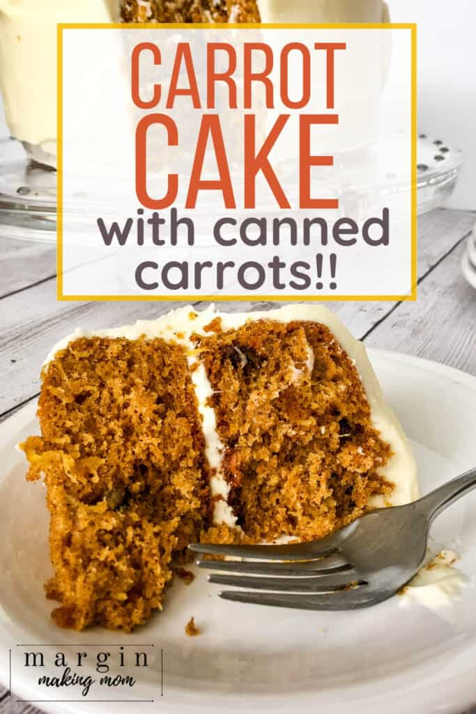 plate with a piece of carrot cake with pineapple and pecans topped with cream cheese frosting