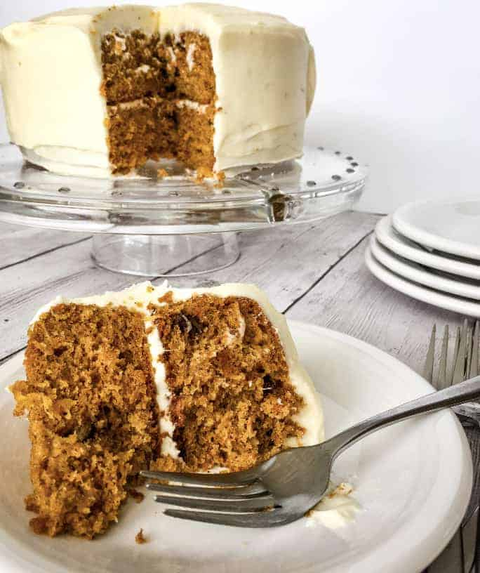 whole carrot cake with a slice removed