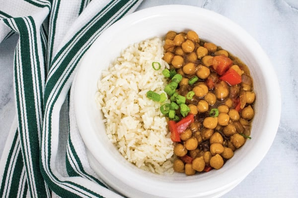 white bowl filled with white rice and Instant Pot kung pao chickpeas