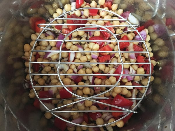 process of using the pot-in-pot method to make kung pao chickpeas