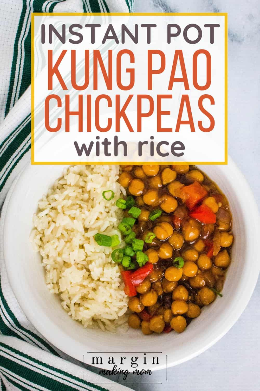 white bowl filled with white rice and kung pao chickpeas, garnished with green onions