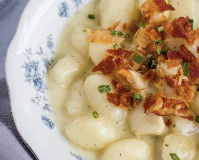 white and blue floral china bowl filled with Instant Pot bacon chicken ranch gnocchi
