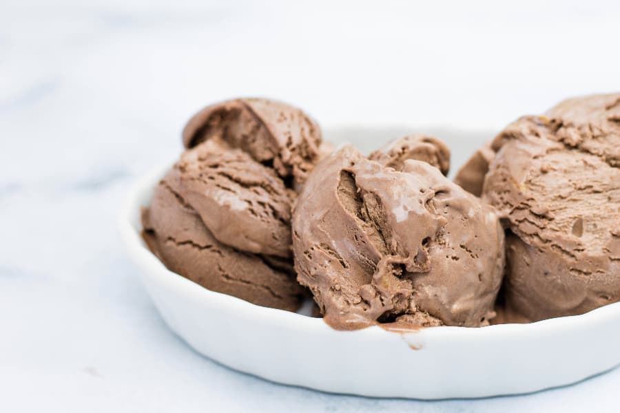 three scoops of homemade no-churn chocolate peanut butter ice cream made with sweetened condensed milk and heavy cream
