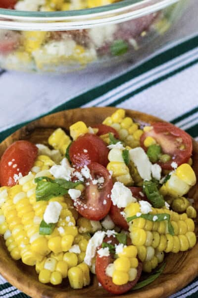 brown bowl filled with corn and tomato salad