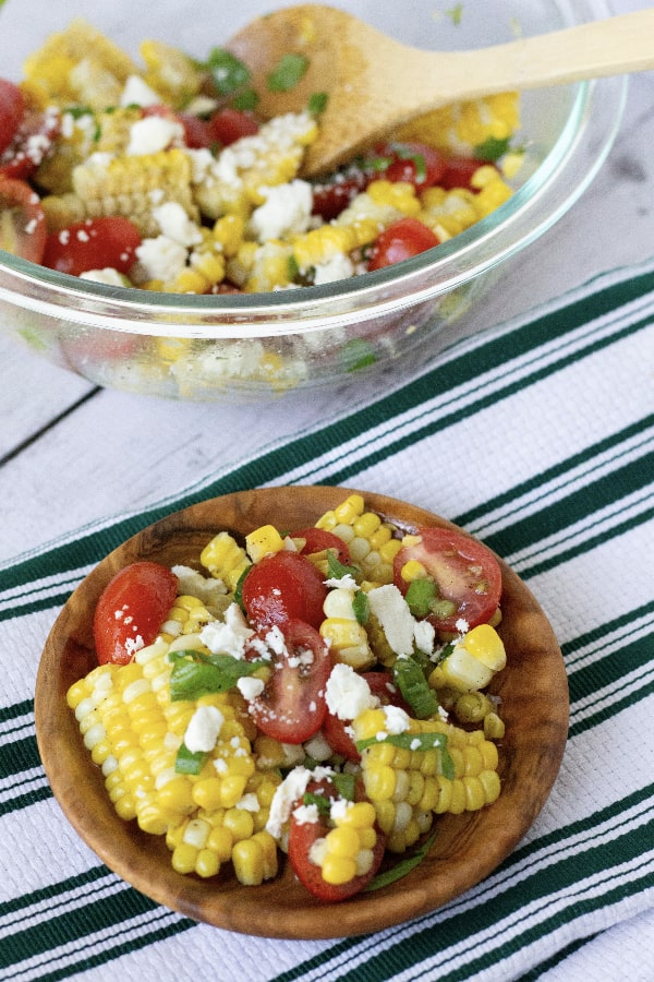 brown bowl filled with summer sweet corn and tomato salad