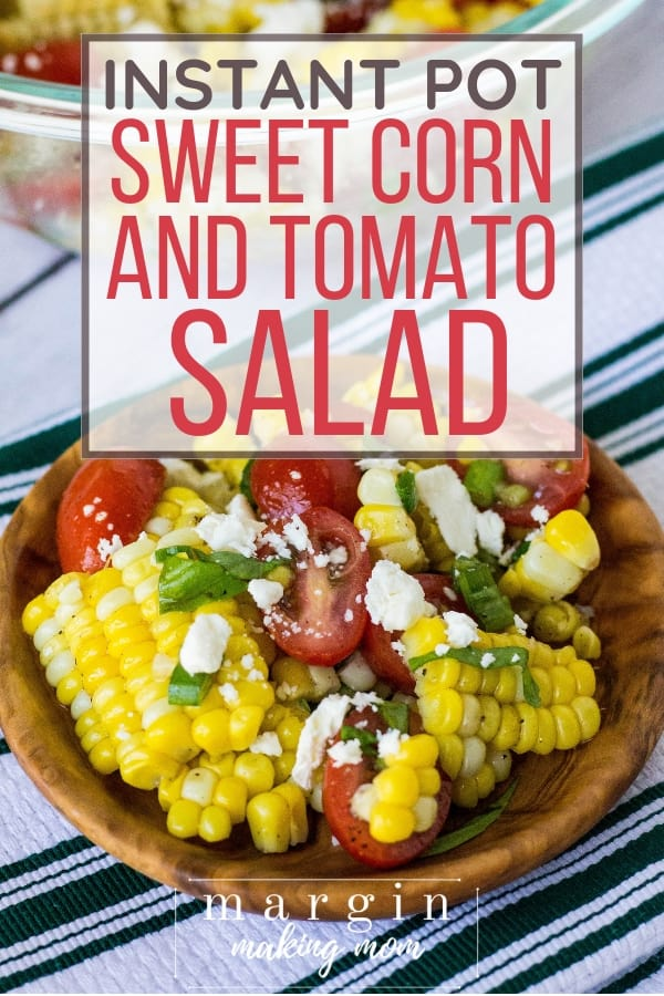 wooden bowl filled with summer corn and tomato salad, where the corn was cooked in the Instant Pot