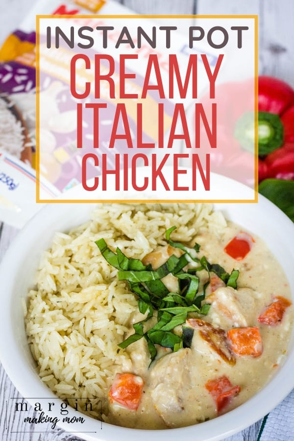 white bowl filled with rice and creamy Italian chicken made in the Instant Pot