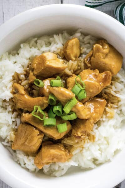 white bowl filled with Instant Pot sesame chicken and rice