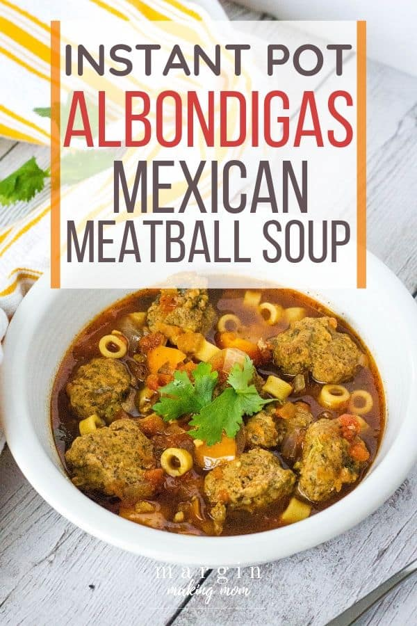 white bowl filled with Instant Pot albondigas soup