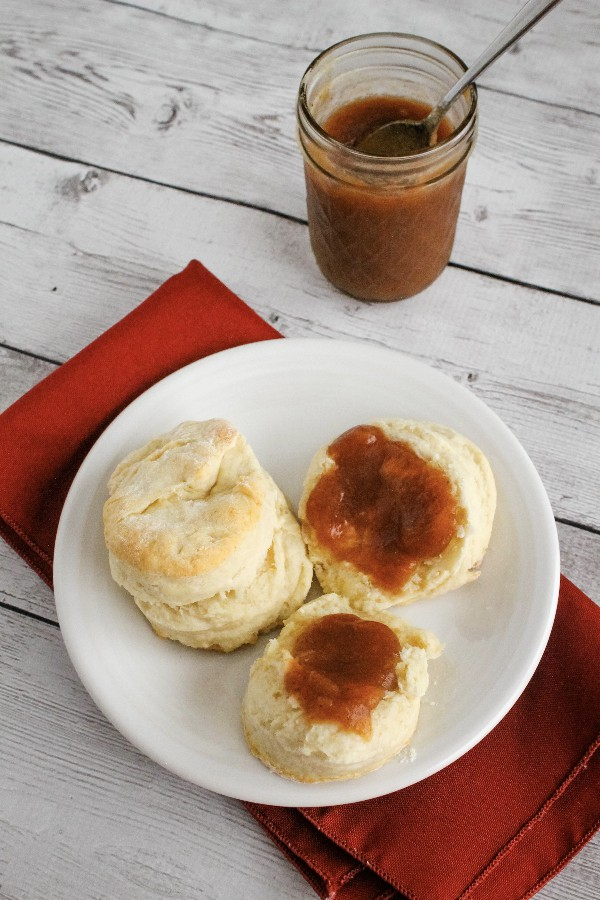 white plate with biscuits topped with apple butter cooked in the Instant Pot