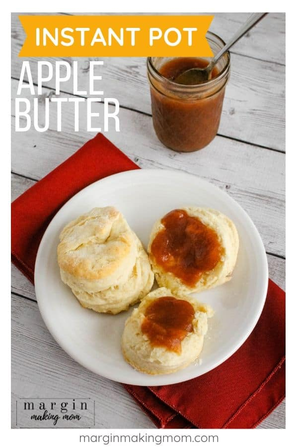 white plate with biscuits on it, topped with apple butter cooked in the Instant Pot