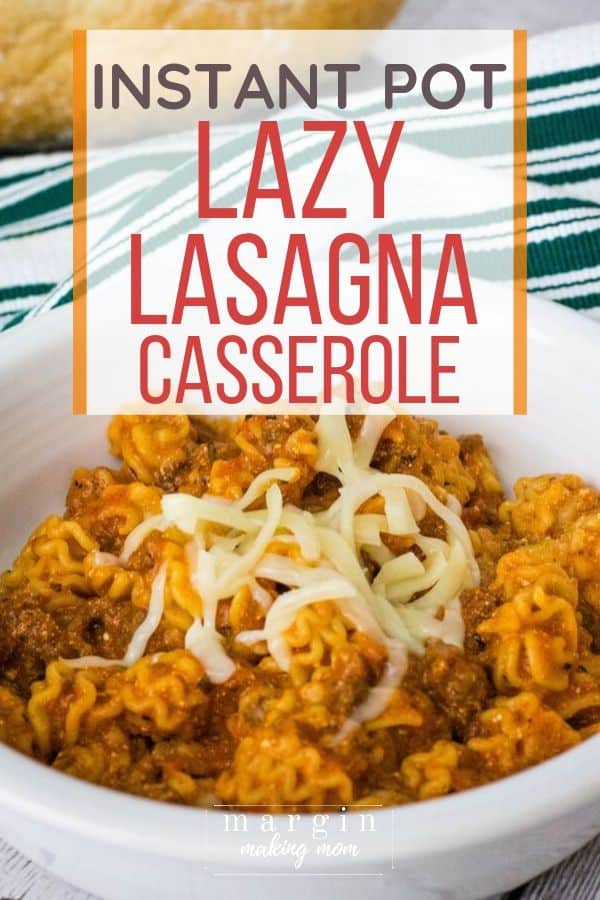 White bowl filled with Instant Pot lazy lasagna casserole and topped with shredded mozzarella cheese