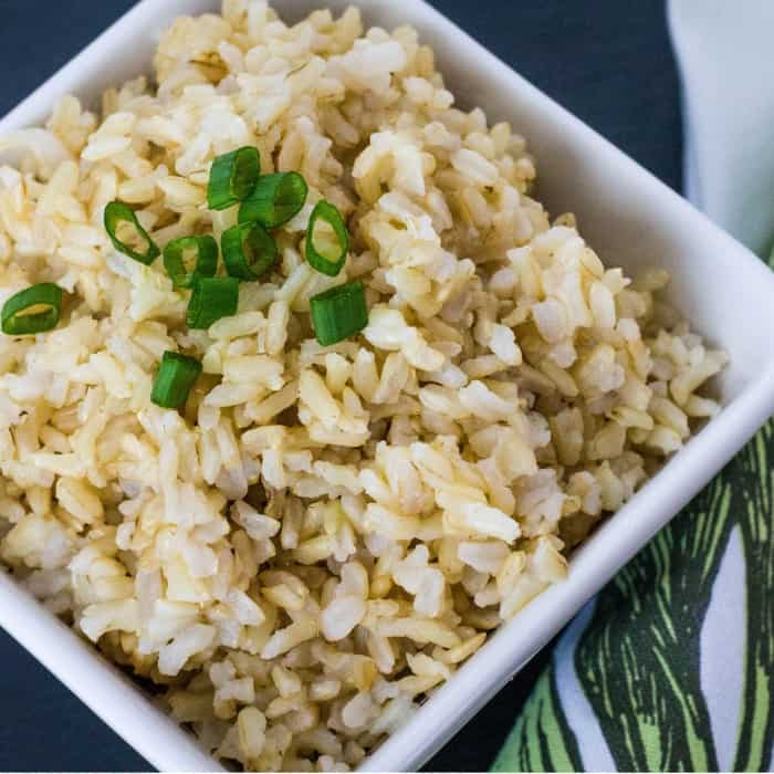 White bowl of brown rice cooked in the Instant Pot, as a good Instant Pot recipe for beginners