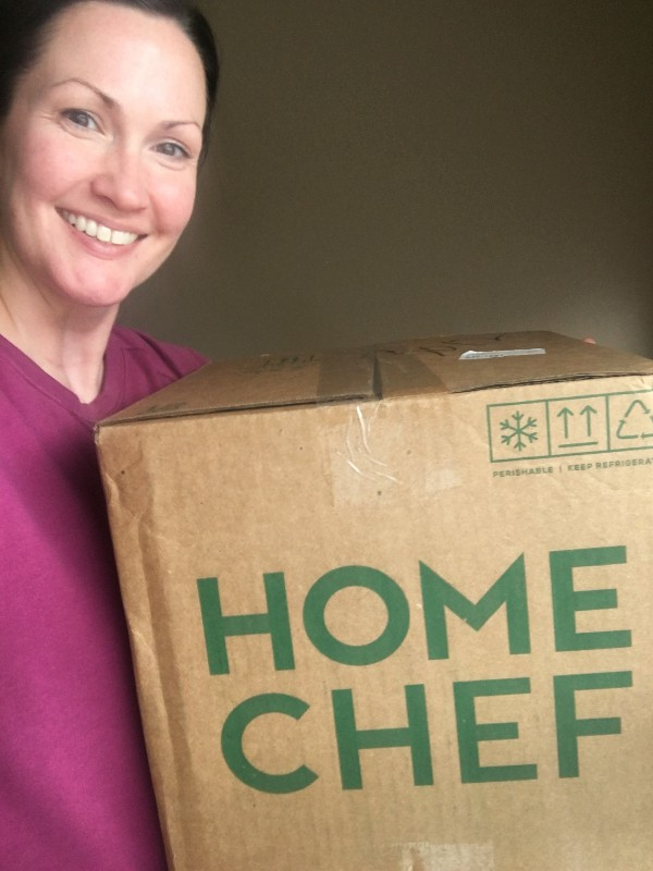 Author holding a Home Chef box