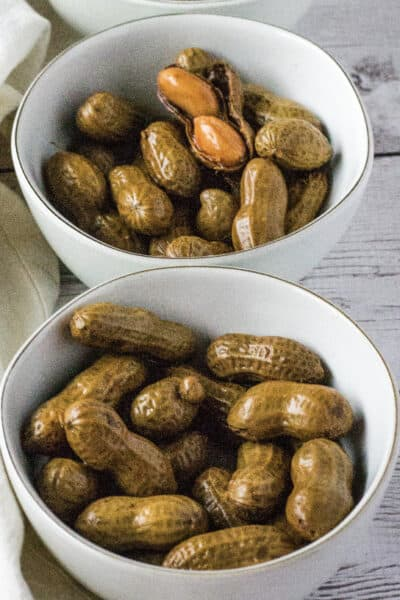 two white bowls filled with Cajun boiled peanuts