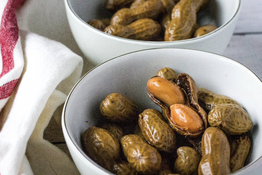 Cajun boiled peanuts in white bowls