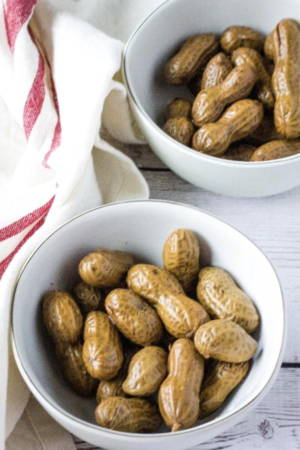 white bowl of cajun boiled peanuts