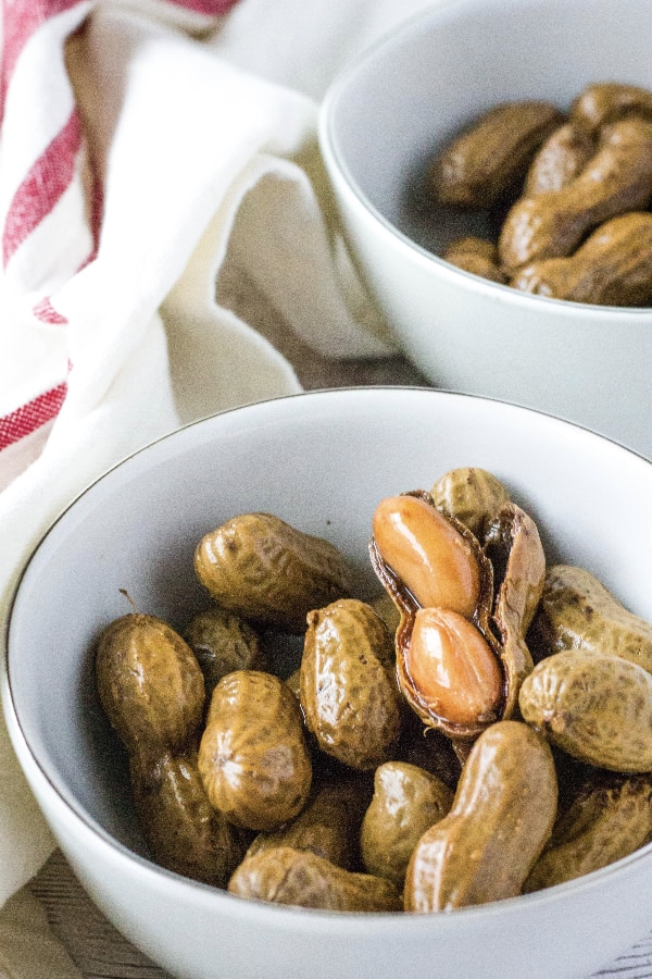 two white bowls of boiled peanuts